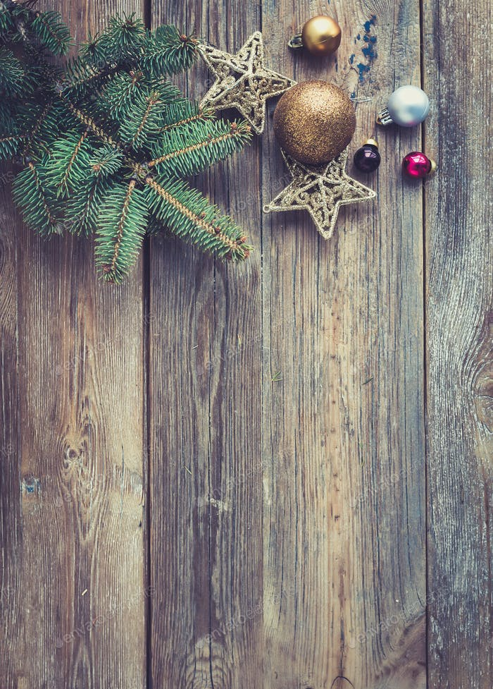 Christmas or New Year rustic wooden background with toy decorations