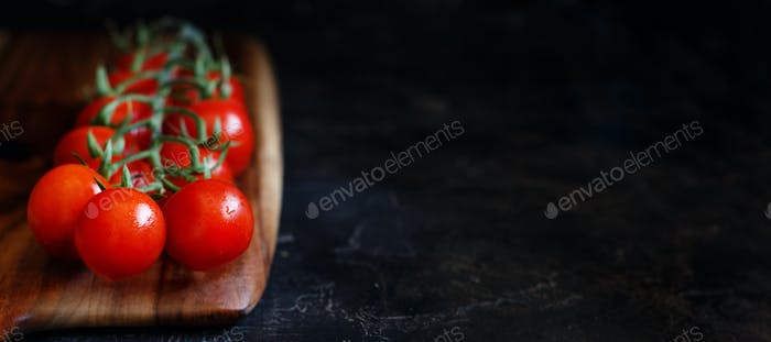 Cherry tomatoes on a wooden board