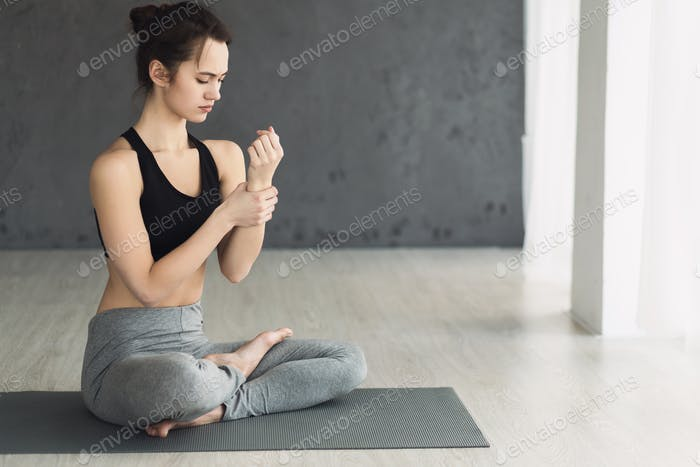 Woman checking pulse after yoga training, free space