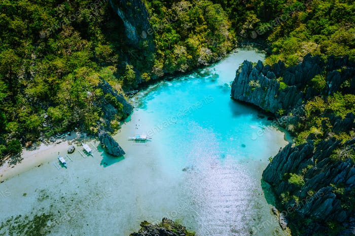 Amazing aerial view of turquoise Cadlao lagoon hopping island El Nido Palawan Philippines. Stunning