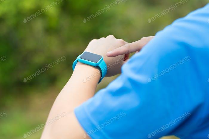 Man using smartwatch with sporty wear