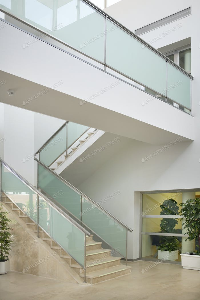 Modern building interior with staircase and walkway. Architecture and construction