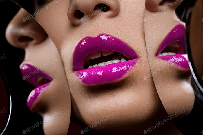 beautiful woman lips closeup with mirror reflections