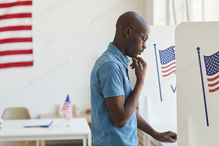 African-American Man in Voting Booth
