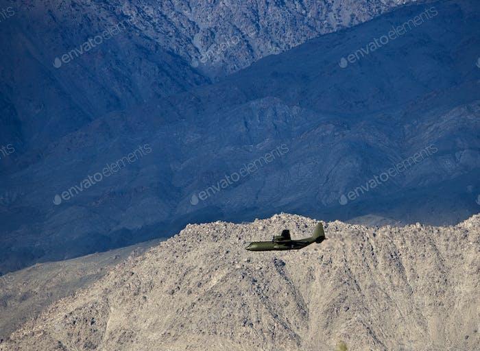 49957,Military plane in desert near Death Valley