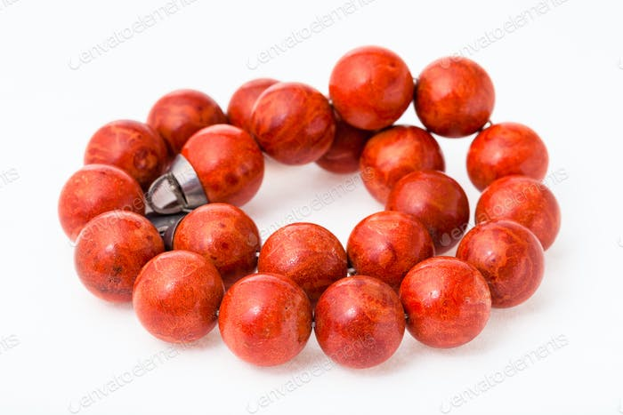 tangled necklace from polished red coral balls