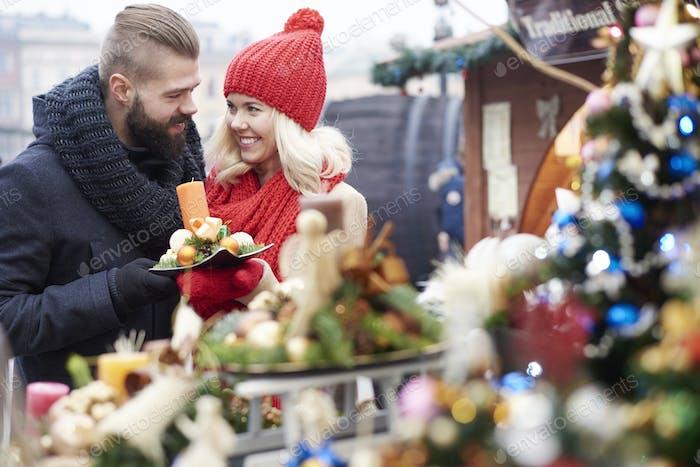 Browsing some christmas ornaments on christmas market