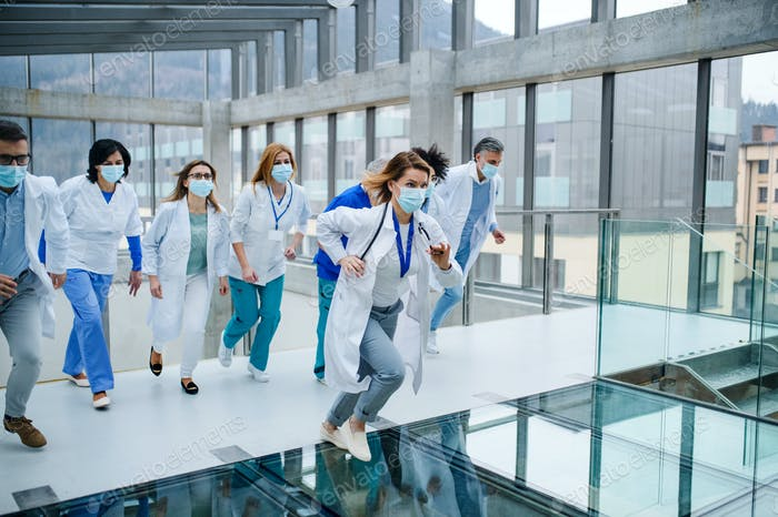 Group of doctors running in corridor of hospital, emergency concept