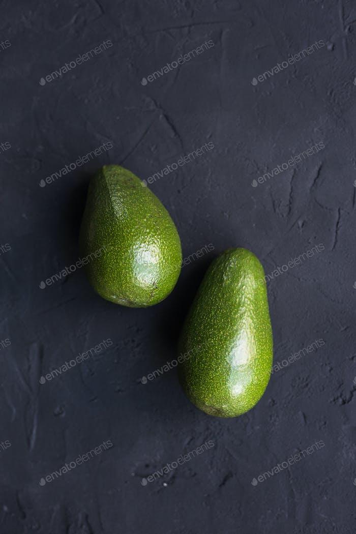 Avocado fruit on a black background