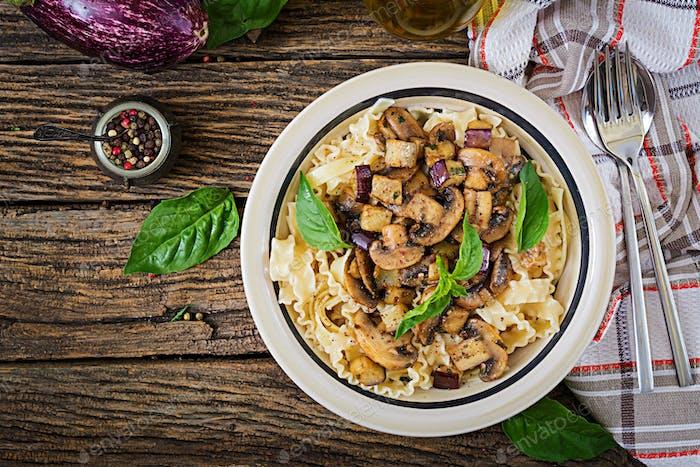Vegetarian pasta with mushrooms and aubergines, eggplants.