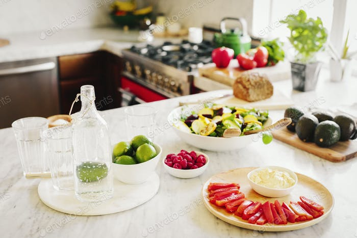 A choice of prepared fresh salads on a kitchen counter.