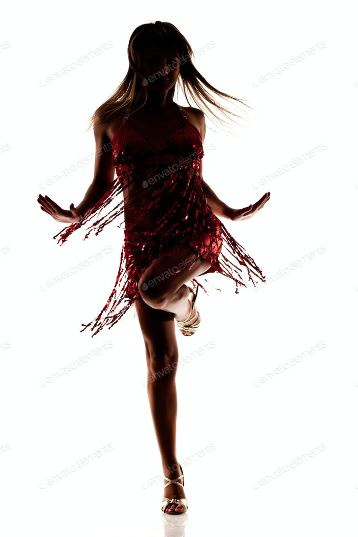 Silhouette of dancing slim beautiful woman in sexy red dress and high heels shoes isolated over