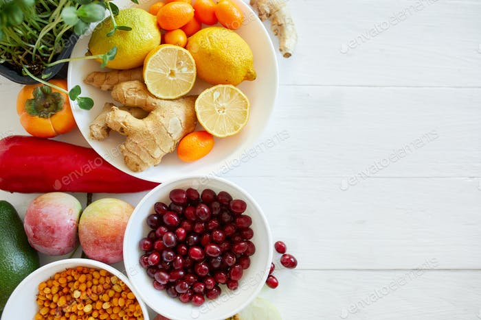 Assortment product of rich in antioxidants and vitamins sources on white wooden background