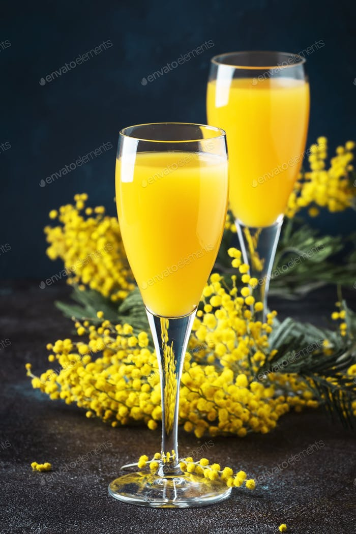 Mimosa alcohol cocktail with orange juice