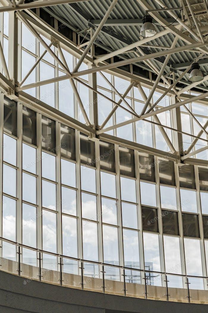 Big windows in industrial interior of factory building