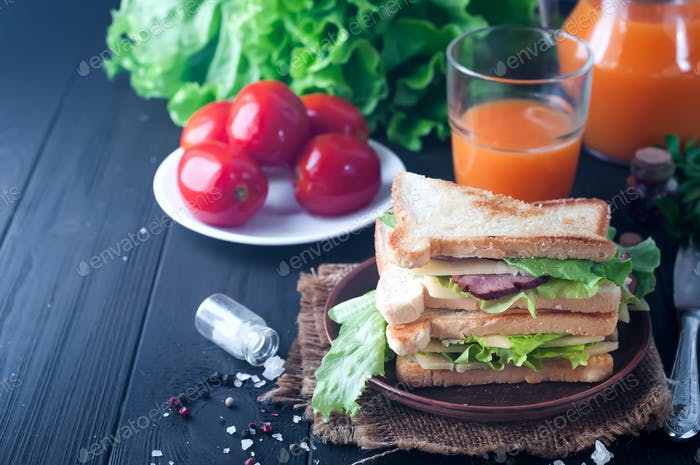 club sandwiches on wood background