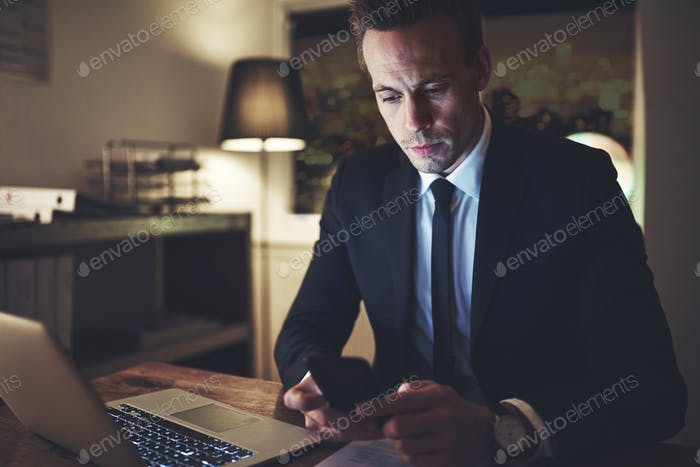 The lawyer browsing his phone in office