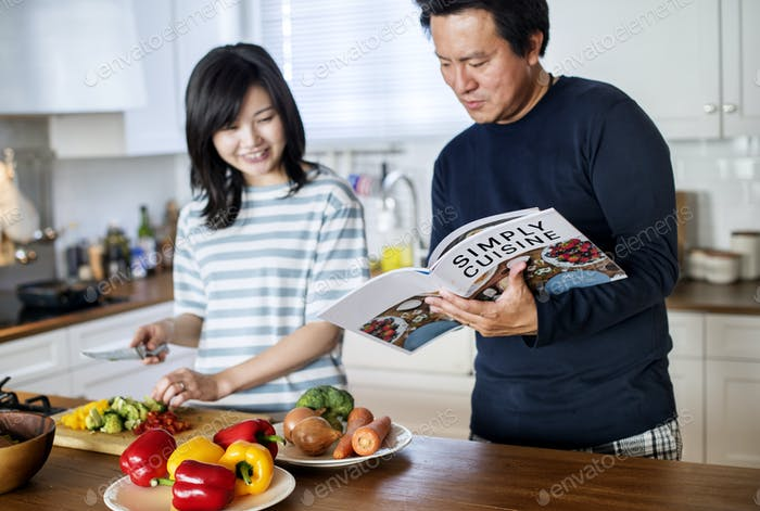 Asian couple cooking in the kitchen