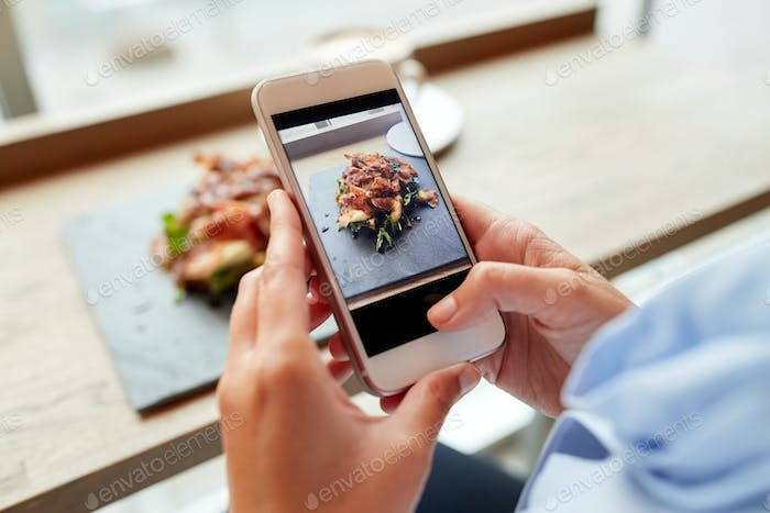 Thumbnail for hands with smartphone photographing food