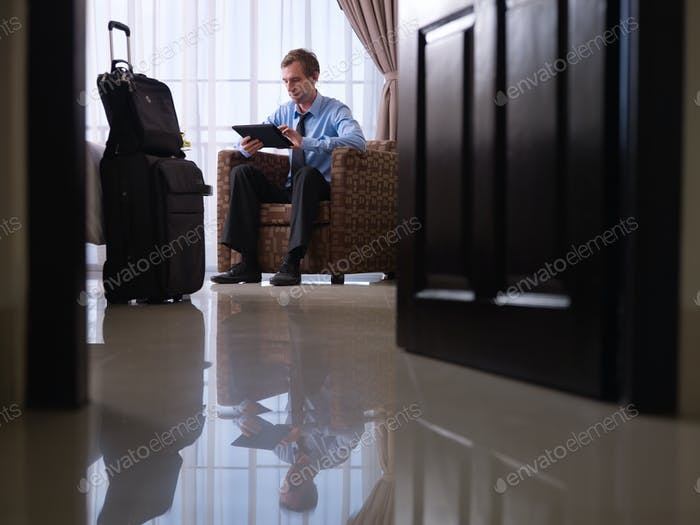 Businessman Using Digital Tablet Pc In Hotel Room