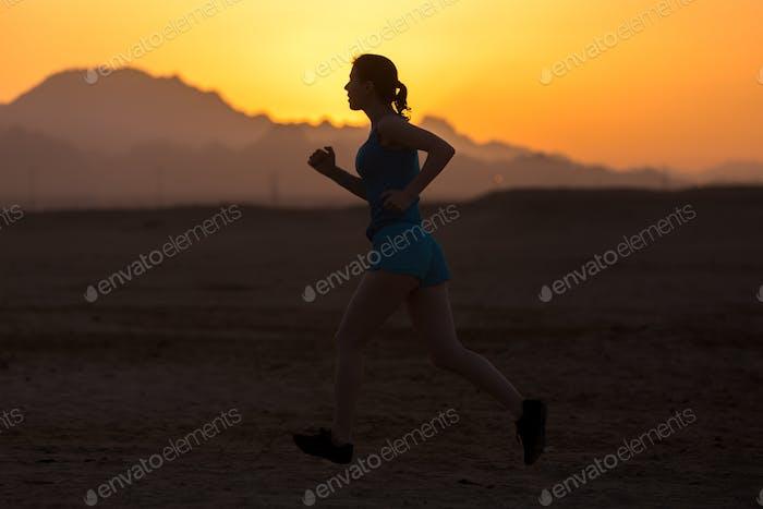 Jogging in mountainous landscape