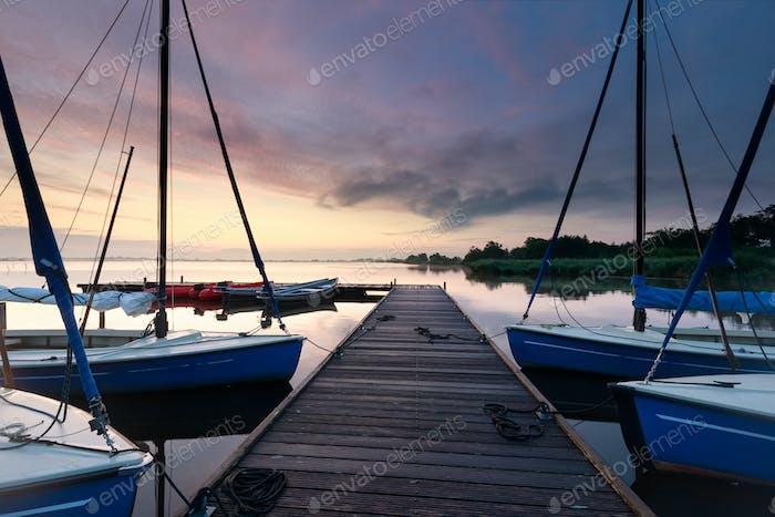 Yachts on lake at sunrise