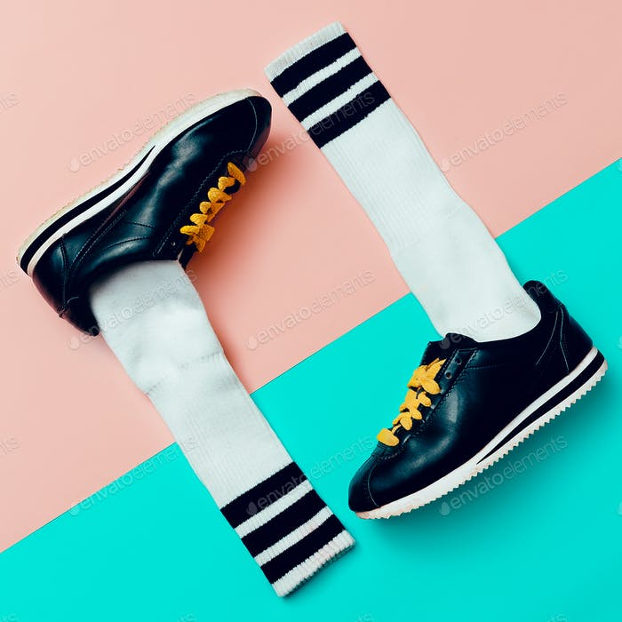 Minimal fashion creative art. Stylish sneakers and socks.