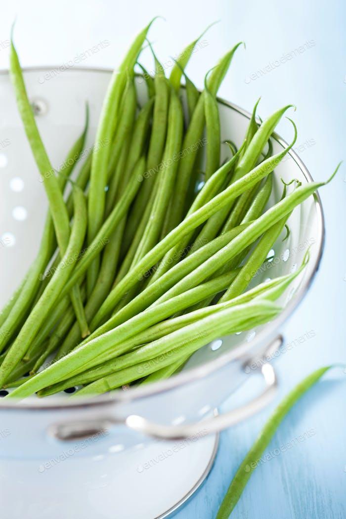 fresh green beans in colander
