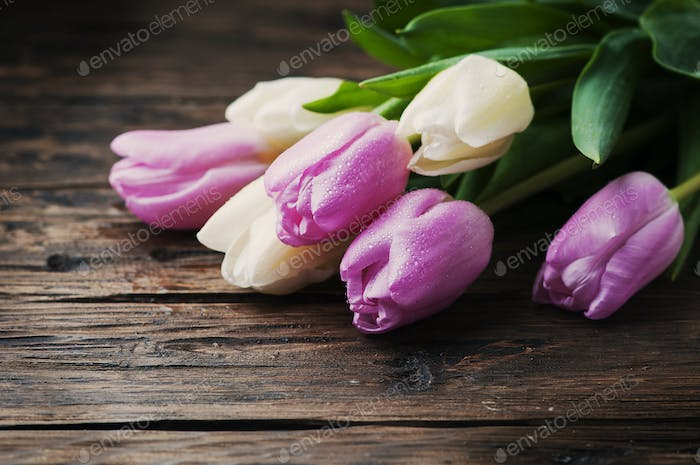 Bouquet of tulips on the wooden table