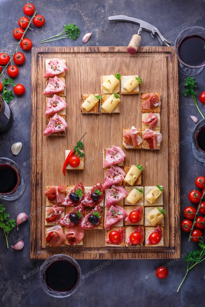 Tiny tapas with jamon, cured meat and cheese