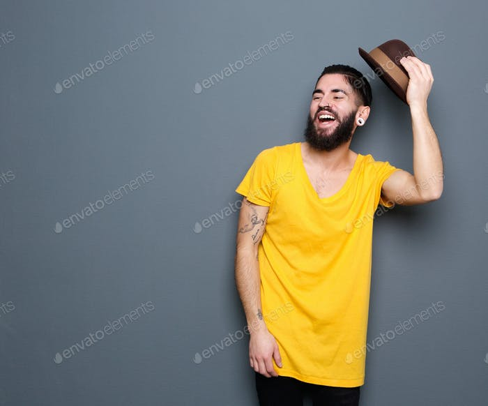 Happy young man with beard laughing