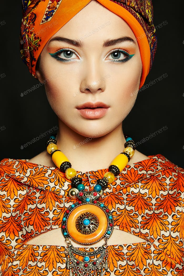 Portrait young beautiful woman with necklace