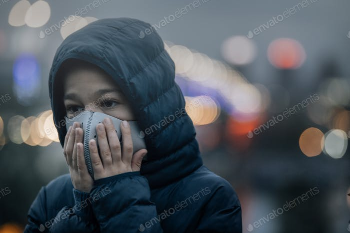 Air Pollution, Child in a City Street with Poor Air Quality