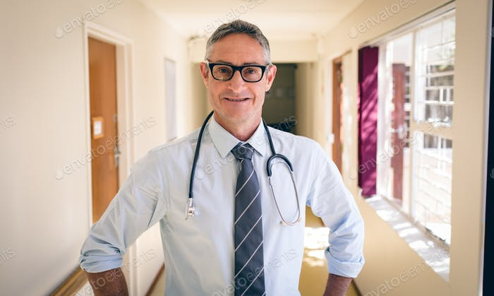 Portrait of matured Caucasian  male doctor standing in corridor at retirement home