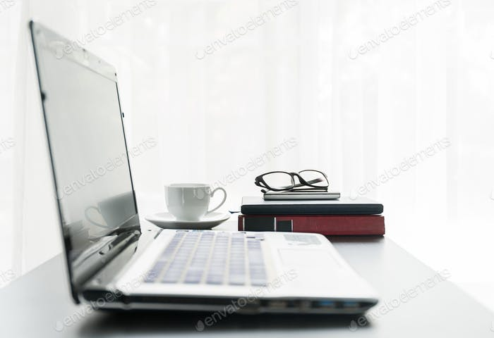 Laptop placed on desktop with coffee cup-3