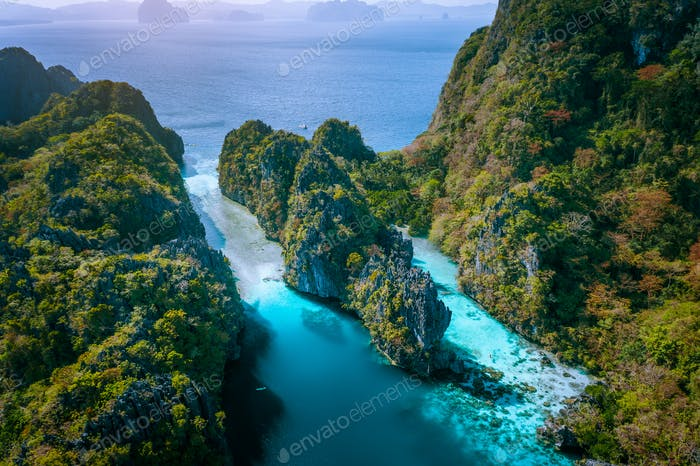 Aerial drone view of entrance to Big and Small Lagoon surrounded by steep cliffs El Nido, Palawan