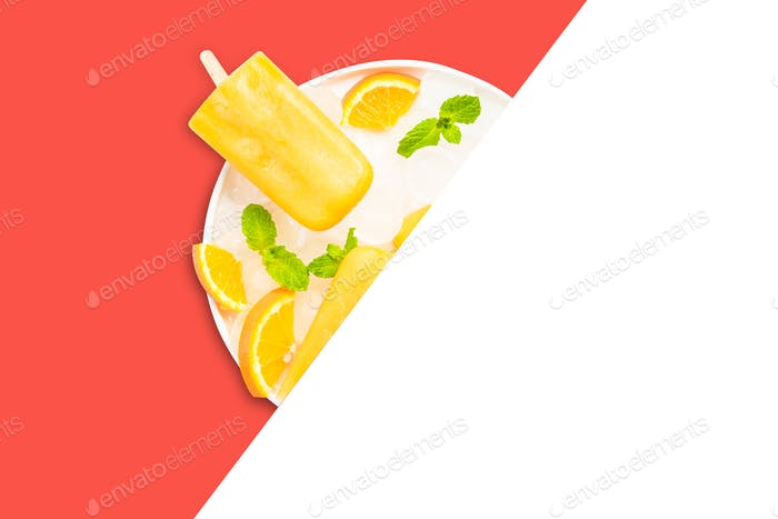 Orange juice popsicles on copy space minimal background