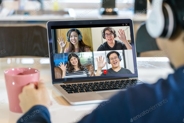 Rear View of Asian Business man say hello with teamwork colleague in video conference