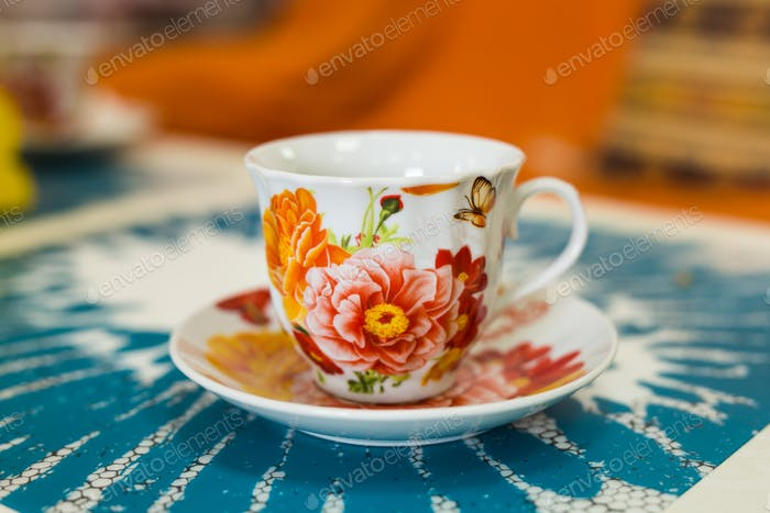 Colorful cup on a colored background
