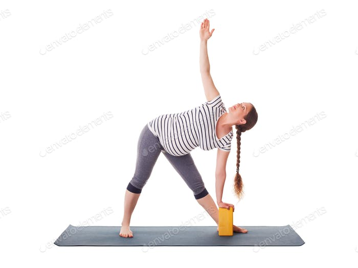 Pregnant woman doing yoga asana Utthita trikonasana