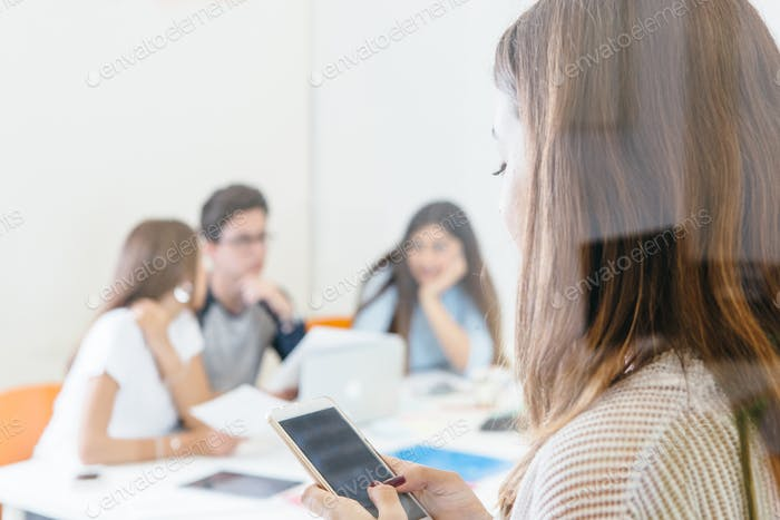 Girl with phone in modern office