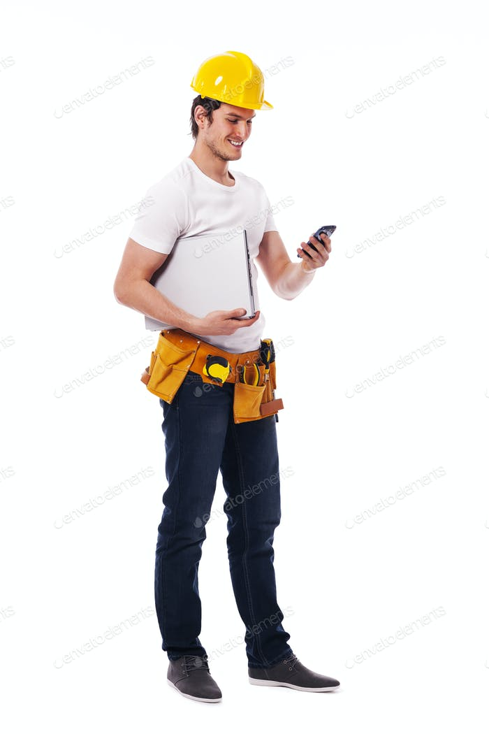 Construction worker checking something on the mobile phone