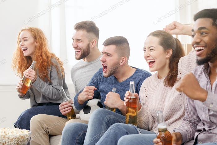 Football fans. Friends watching soccer on tv