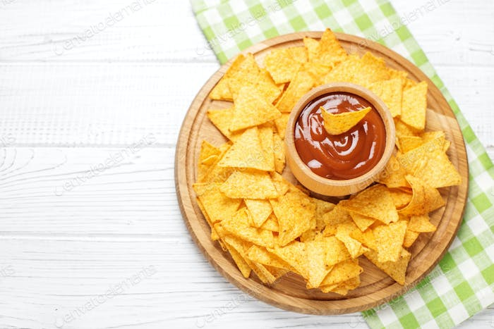 Chips Nachos with sauce. Flat lay. Concept - bad food, cafe, pub