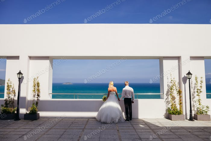 wedding couple relax on beach resort