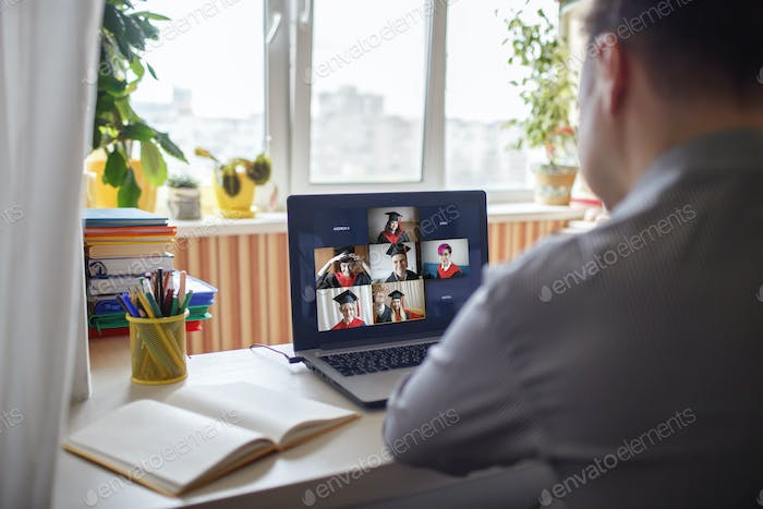 Virtual graduation ceremony. Students receiving congratulation from family during online video call