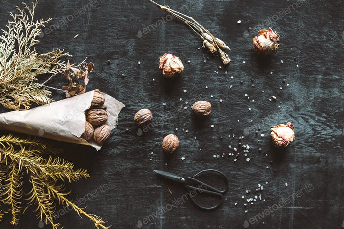 Walnuts on a old rustic table. Walnuts in a paper bag