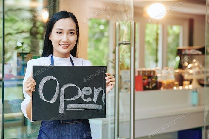 Cafe owner opening cafe