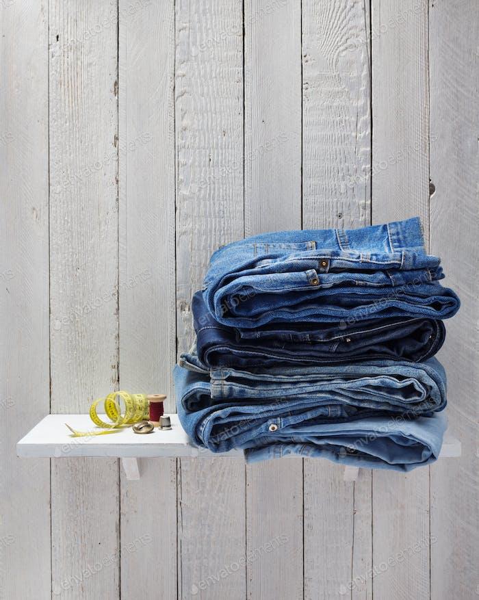 blue jeans on wooden shelf