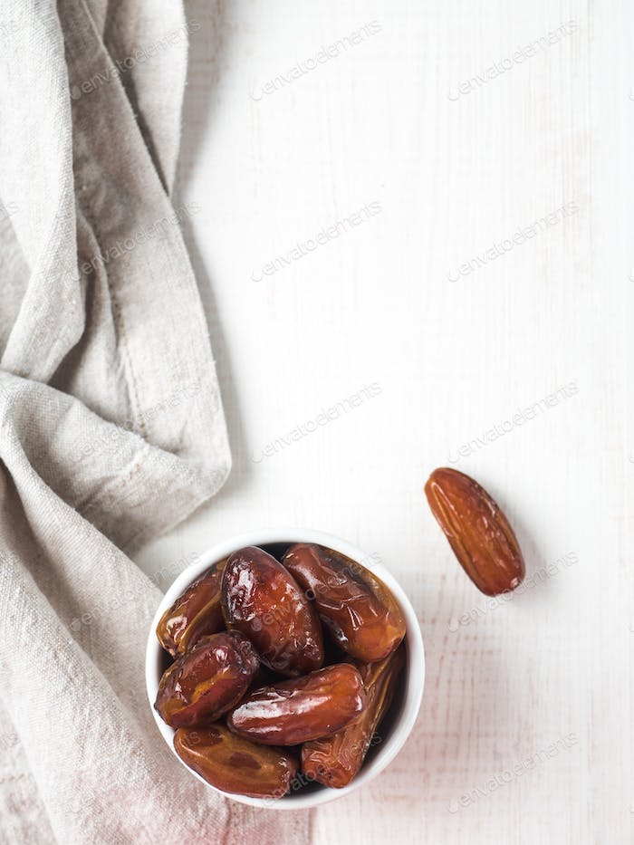 Plate of dried dates on table